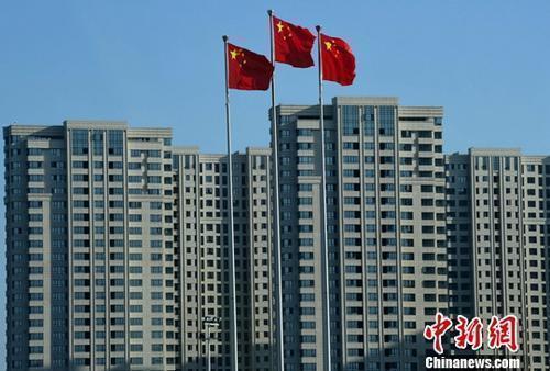 资料图:一处刚建设完工的房地产楼盘。 <a target='_blank' href='http://www.chinanews.com/' _fcksavedurl='http://www.chinanews.com/'></table>中新社</a>记者 张斌 摄