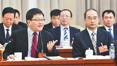 3月14日,甘肃代表团刘昌林代表在审议国务院机构改革方案时发言。   本报记者 陈 斌摄