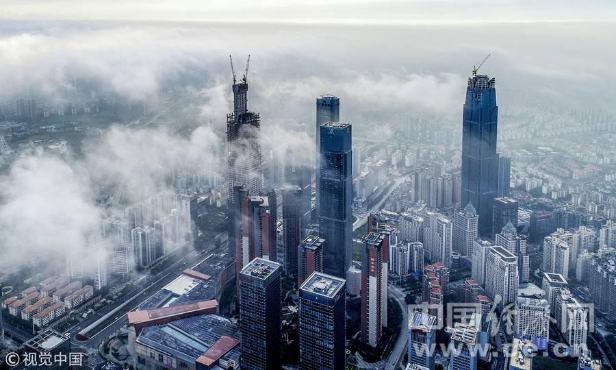 98彩票网急速赛车:云遮雾绕南宁城_雨后楼群犹处仙境