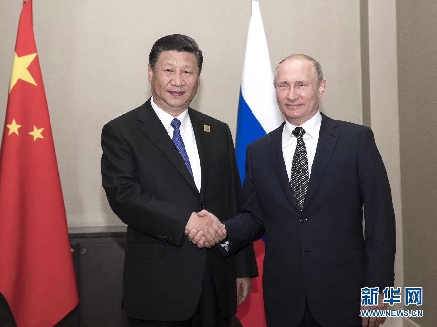 6月8日,国家主席习近平在阿斯塔纳会见俄罗斯总统普京。 新华社记者兰红光 摄