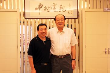 洪虎与中国经济网总裁王旭东合影1.JPG