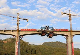 Chinese firm completes beam closure along China-Laos railway