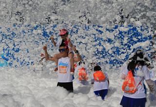 People take part in bubble run in Beijing