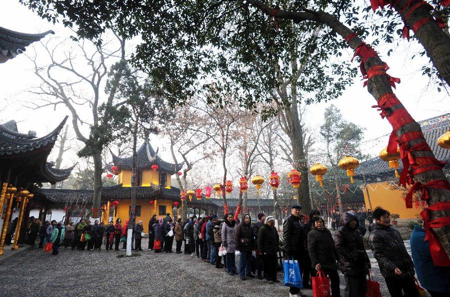 Citizens queue to get free Laba porridge