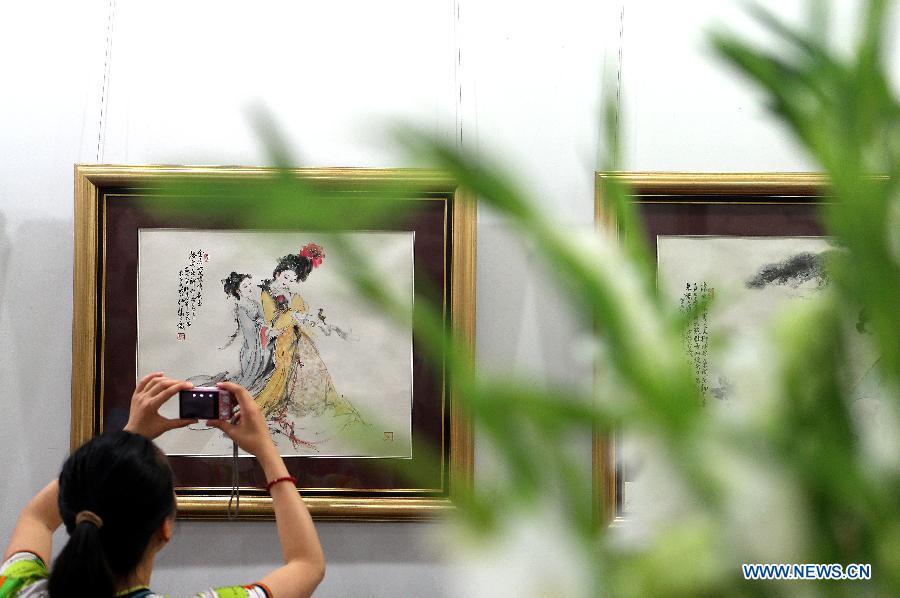 Famed artist's paintings exhibited in Beijing