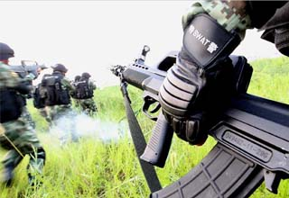 Armed policemen conduct combat exercises in Shanghai