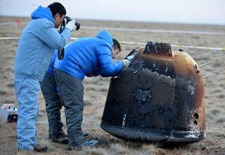 China's unmanned lunar orbiter returns home