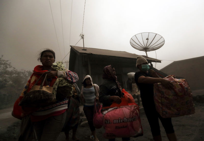 New volcano eruptions force more Indonesians to ev