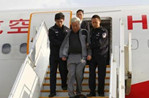 Two graft-involved Chinese fugitives taken back from Laos
