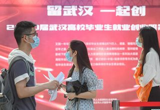 Wuhan holds first offline job fair since virus outbreak