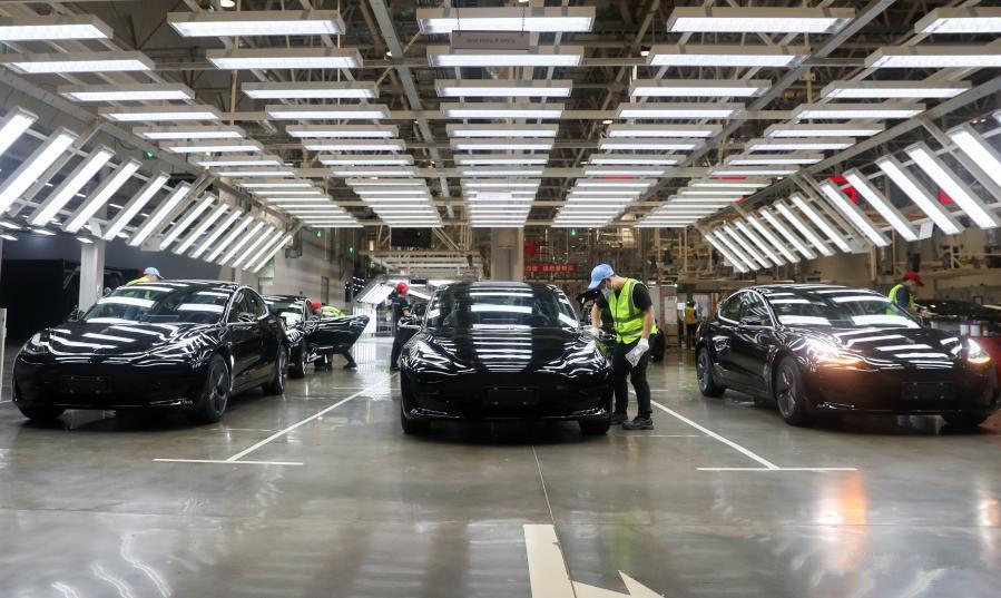 Employees work at Tesla Gigafactory in Shanghai