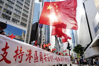 Chinese lawmakers starting deliberating draft decision on improving HKSAR electoral system