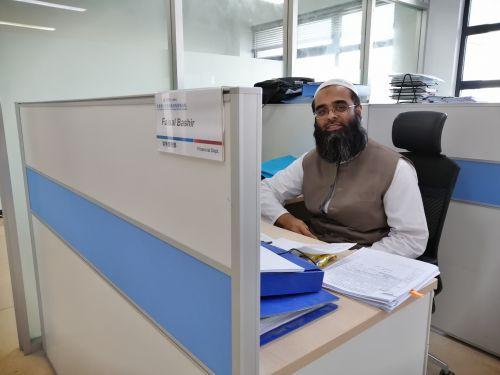 A bushy-bearded Pakistani who serves Qasim power plant -- CPEC role model