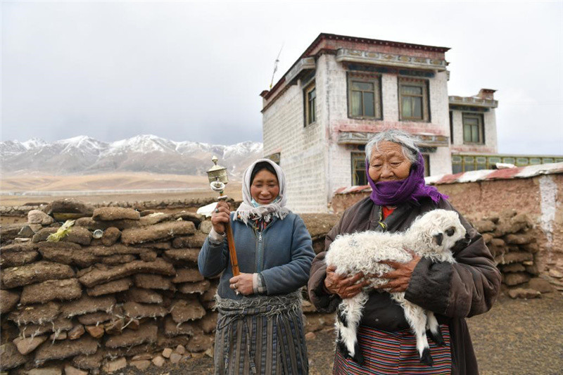 Former serf enjoys happy life after democratic reform in Tibet