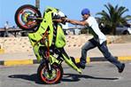 Libyan young men show motorcycle riding skills