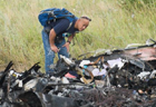 Malaysian investigators inspect crash site of MH17