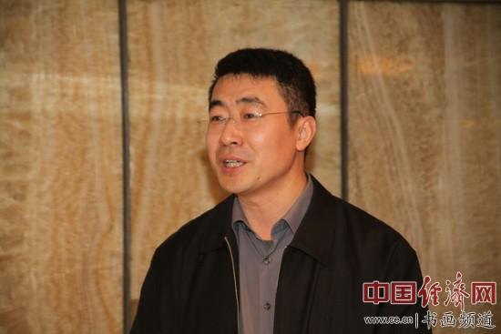 金融书法家协会理事、书法理论学者朱宝明 李玉生摄