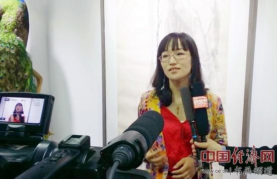 李晓娣在现场接受采访 中国经济网记者李冬阳摄