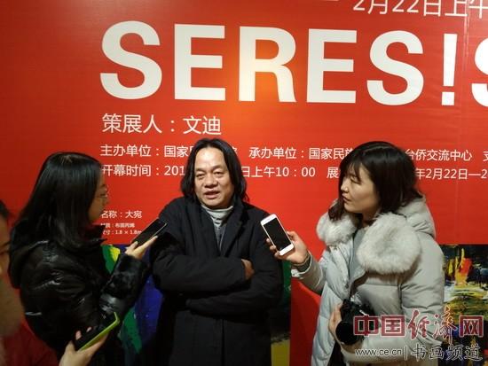 张肇达在现场接受采访 中国经济网记者李冬阳摄