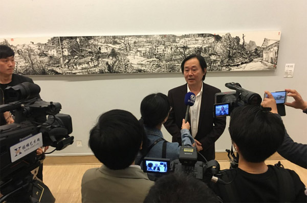 梁明先生接受采访